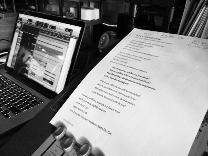 Lyrics of Hey Changeling on a mixing console next to a laptop