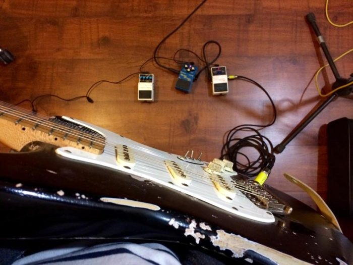 A Stratocaster guitar and some effects pedals